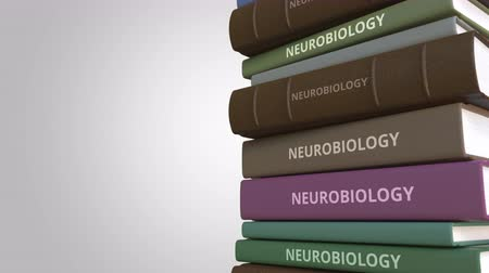 livros didáticos : NEUROBIOLOGY title on the stack of books, conceptual loopable 3D animation