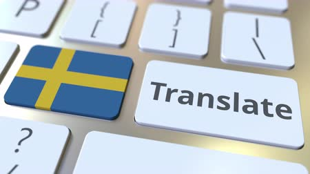 İsveççe : TRANSLATE text and flag of Sweden on the buttons on the computer keyboard. Conceptual 3D animation Stok Video