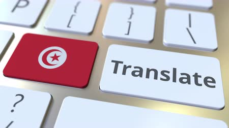 tunus : TRANSLATE text and flag of Tunisia on the buttons on the computer keyboard. Conceptual 3D animation