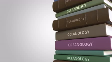 oceány : OCEANOLOGY title on the stack of books, conceptual loopable 3D animation