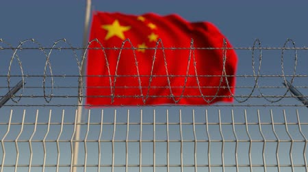 hapsedilme : Blurred waving flag of China behind barbed wire fence. Loopable 3D animation Stok Video