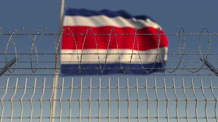 vazba : Defocused waving flag of Costa rica behind barbed wire fence. Loopable 3D animation