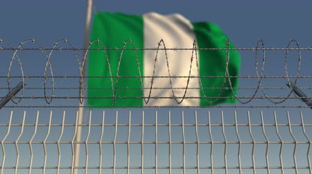 nigeria flag : Defocused waving flag of Nigeria behind barbed wire fence. Loopable 3D animation