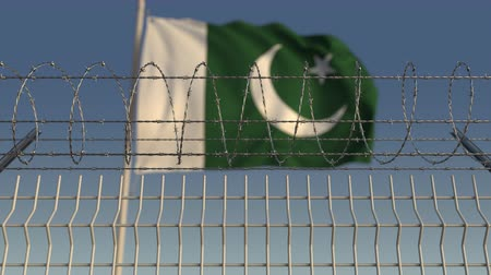 vazba : Defocused waving flag of Pakistan behind barbed wire fence. Loopable 3D animation