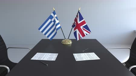 greece flag : Flags of Greece and Great Britain and papers on the table. Negotiations and signing an international agreement. Conceptual 3D animation