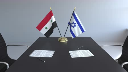syrian : Flags of Syria and Israel and papers on the table. Negotiations and signing an international agreement. Conceptual 3D animation Stock Footage