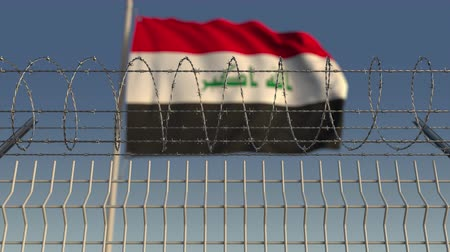 korlátozás : Barbed wire against waving flag of Iraq. Loopable 3D animation