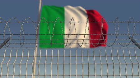 farpado : Defocused waving flag of Italy behind barbed wire fence. Loopable 3D animation