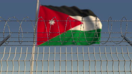 vazba : Barbed wire against waving flag of Jordan. Loopable 3D animation