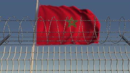 hapsedilme : Defocused waving flag of Morocco behind barbed wire fence. Loopable 3D animation