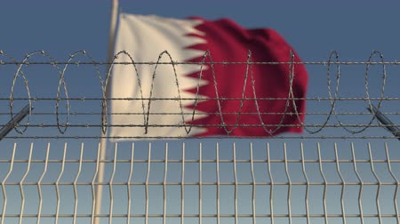 hapsedilme : Blurred waving flag of Qatar behind barbed wire fence. Loopable 3D animation Stok Video