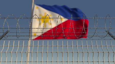 sınırları : Barbed wire against waving flag of Philippines. Loopable 3D animation Stok Video
