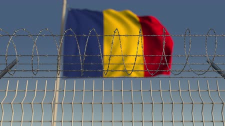 vazba : Defocused waving flag of Romania behind barbed wire fence. Loopable 3D animation