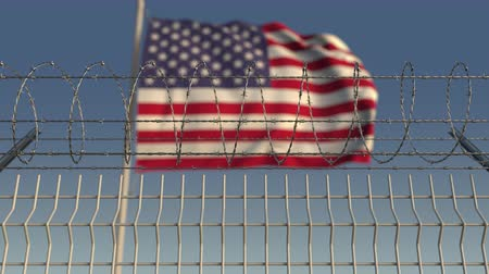 farpa : Defocused waving flag of the United States behind barbed wire fence. Loopable 3D animation Stock Footage