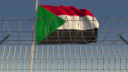 sudanian : Defocused waving flag of Sudan behind barbed wire fence. Loopable 3D animation