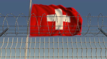 hapsedilme : Barbed wire against waving flag of Switzerland. Loopable 3D animation Stok Video