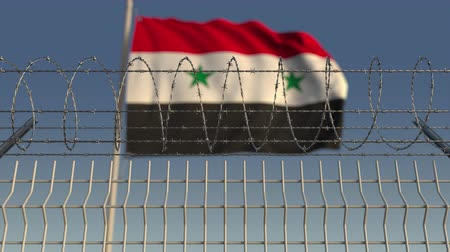 sınırları : Blurred waving flag of Syria behind barbed wire fence. Loopable 3D animation Stok Video