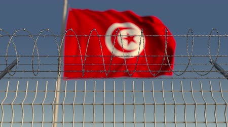 heg : Barbed wire against waving flag of Tunisia. Loopable 3D animation
