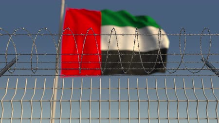 boundary : Barbed wire against waving flag of the UAE. Loopable 3D animation