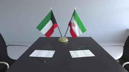 diplomatie : Drapeaux du Koweït et de l'Iran et papiers sur la table. Négociations et signature d'un accord international. Animation 3D conceptuelle
