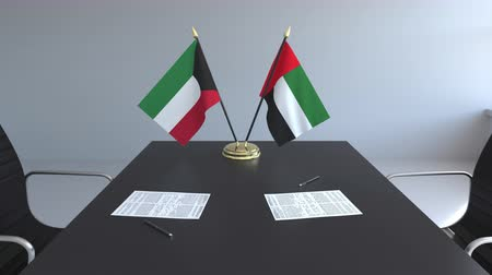 assinatura : Flags of Kuwait and the UAE and papers on the table. Negotiations and signing an international agreement. Conceptual 3D animation Vídeos