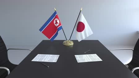corée du nord : Flags of North Korea and Japan and papers on the table. Negotiations and signing an international agreement. Conceptual 3D animation