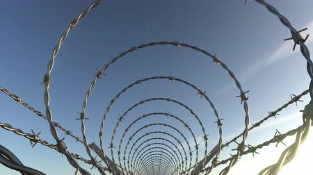 barreira : POV moving shot inside barbed wire spiral fence, seamless loop