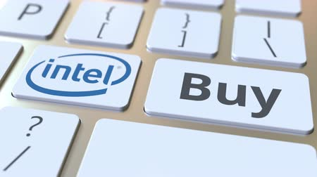 intel : Keyboard with INTEL company logo and Buy text on the keys. Editorial conceptual animation Stock Footage