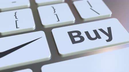 e ticaret : NIKE company logo and Buy text on the keys of the computer keyboard, editorial conceptual animation Stok Video