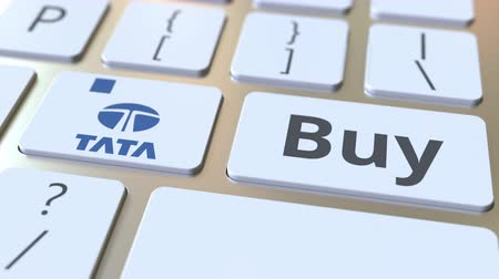 e ticaret : TATA company logo and Buy text on the keys of the computer keyboard, editorial conceptual animation