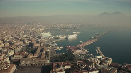 ferry terminal : NAPLES, ITALY - DECEMBER 29, 2018. Picturesque aerial view of the Stazione Marittima Cruise Ship Terminal and the cityscape