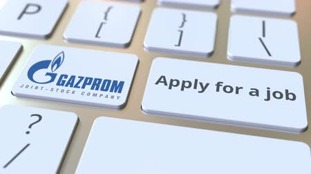 gazprom : GAZPROM company logo and Apply for a job text on the keys of the computer keyboard, editorial conceptual animation