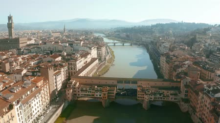 arno : Picturesque aerial view of Ponte Vecchio bridge and Arno river within cityscape of Florence, Italy