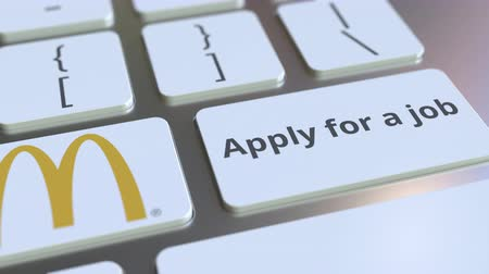 posição : MCDONALDS company logo and Apply for a job text on the keys of the computer keyboard, editorial conceptual animation Stock Footage
