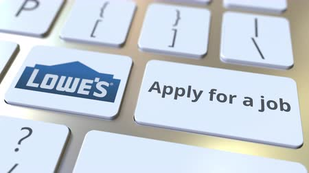 posição : LOWES company logo and Apply for a job text on the keys of the computer keyboard, editorial conceptual animation Stock Footage