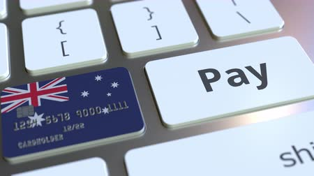 debet : Bank card featuring flag of Australia as a key on a computer keyboard. Australian online payment conceptual animation