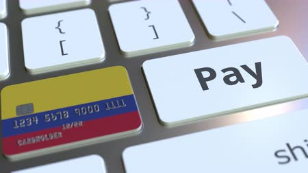 colômbia : Bank card featuring flag of Colombia as a key on a computer keyboard. Colombian online payment conceptual animation
