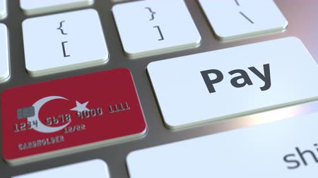 дебет : Bank card featuring flag of Turkey as a key on a computer keyboard. Turkish online payment conceptual animation