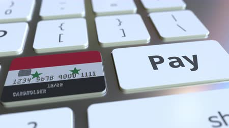 потребитель : Bank card featuring flag of Syria as a key on a computer keyboard. Syrian online payment conceptual animation Стоковые видеозаписи