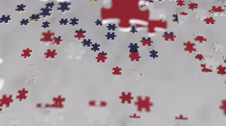 consist : Flag of Malaysia being made with jigsaw puzzle pieces. Malaysian problem solution conceptual 3D animation