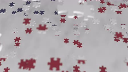 consist : Flag of the USA being made with jigsaw puzzle pieces. American problem solution conceptual 3D animation