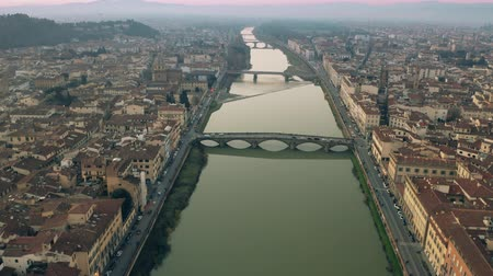 arno : Aerial shot of bridges and the Arno river in Florence in the evening, Italy Stock Footage