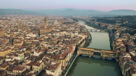 arno : Crowded Ponte Vecchio bridge in the evening, aerial view. Florence, Italy