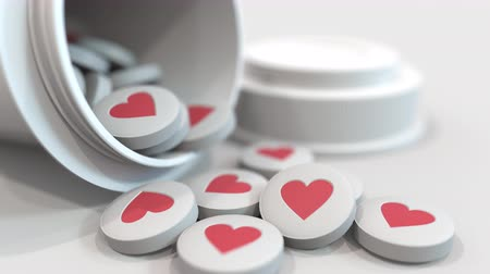 cardiological : Close-up shot of pills with stamped heart symbol on them. 3D animation Stock Footage