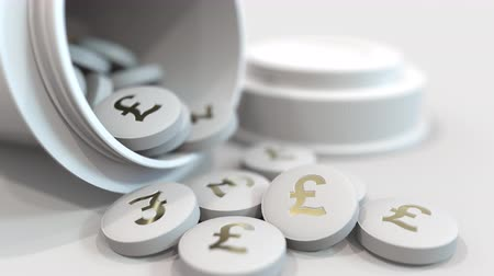 esterlino : Close-up shot of pills with stamped pound sterling GBP symbol on them. Expensive drugs or financial remedy conceptual animation