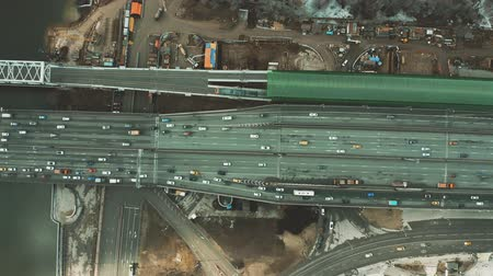 multiple lane : Aerial top down view of city highway, railroad station and road construction site