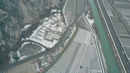 działka : Aerial view of snow covered fields, roads and mountains in northern Italy