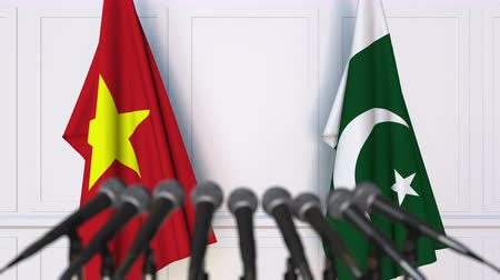 press conference : Flags of Vietnam and Pakistan at international meeting or negotiations press conference. 3D animation