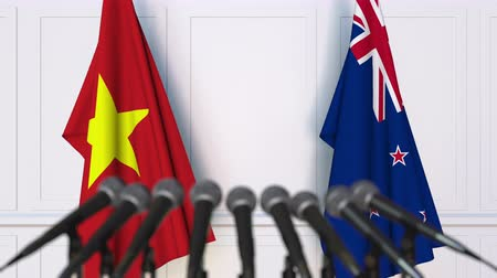 nowa zelandia : Flags of Vietnam and New Zealand at international meeting or negotiations press conference. 3D animation