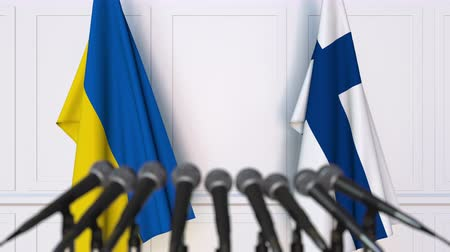 press conference : Flags of Ukraine and Finland at international meeting or negotiations press conference. 3D animation Stock Footage